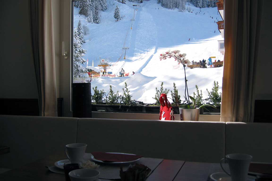 View from the breakfast room of the Garni Hotel Arya Alpine Lodge towards the ski slope Freina