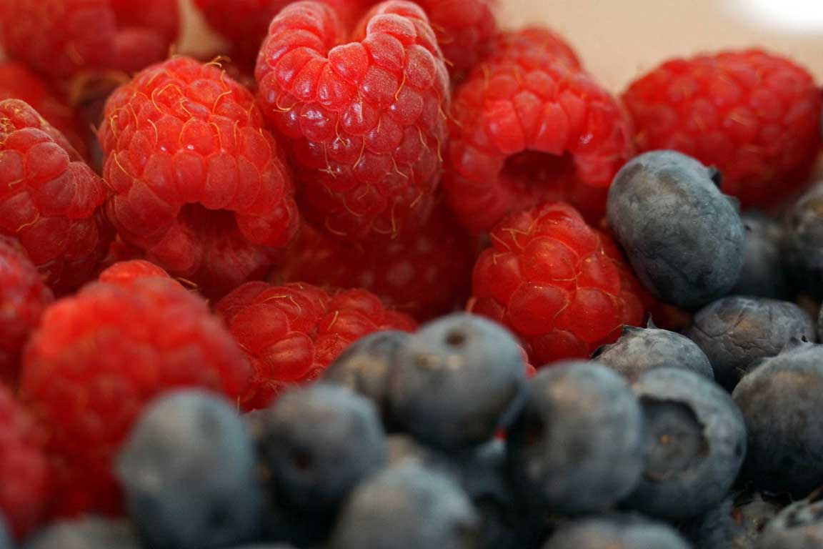 Seasonal fruits - raspberries and blueberries