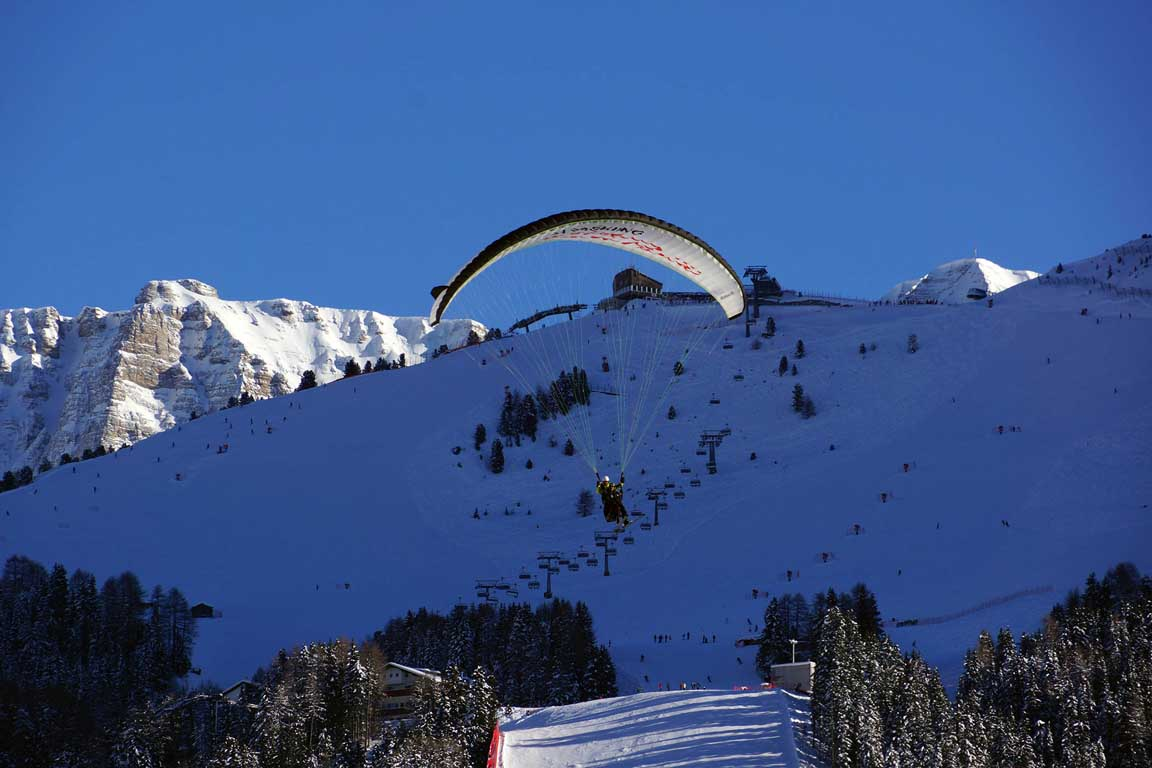 Paragliders over the Monte Pana in the winter