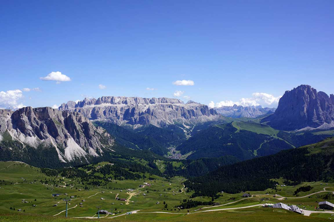 Dolomite mountains: View from the Seceda towards the Sella Group and Selva Val Gardena in summer
