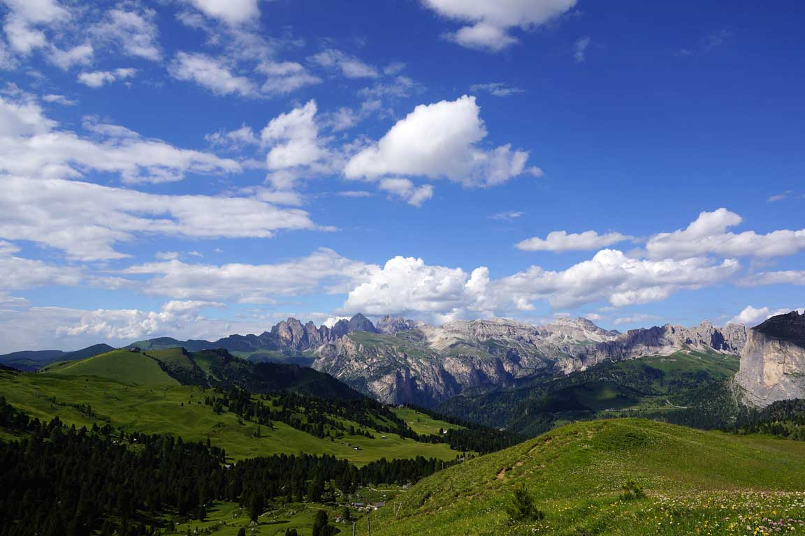 Dolomite mountains: View from Città dei Sassi towards Piz Sella, Odle, Stevia and the Pizes de Cir mountain range in summer
