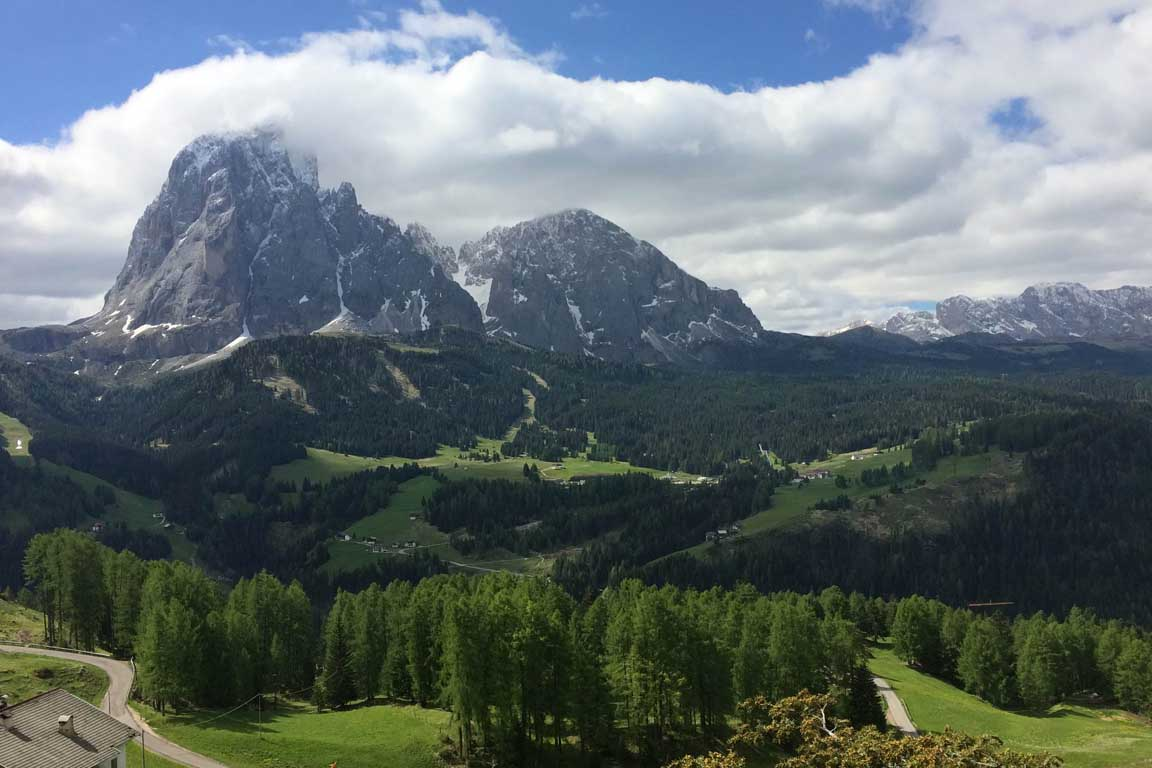 Hiking, walking in spring - View towards the Sassolungo, Sasso PIatto and Monte Pana in Val Gardena